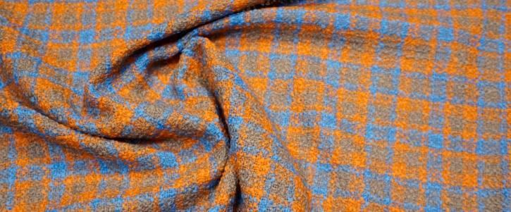 Schurwollboucle - orange/blau
