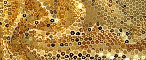 ecrufarbener Tüll mit Paillette in gold