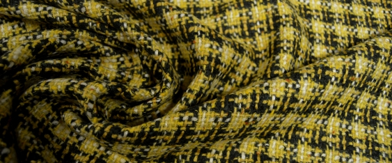 Coupon Schurwollmischung, schwarz - gelb kariert