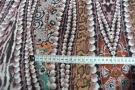 Satin in Stretchqualität - Perlenmotiv